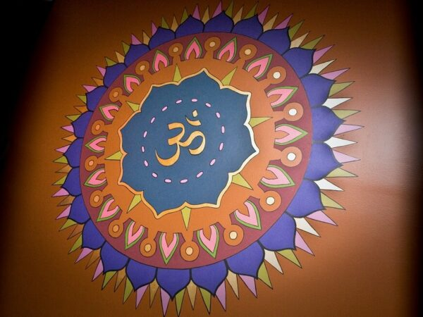 OM symbol painted on the wall of a yoga studio
