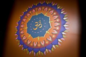 decorative OM symbol painted on the wall of a yoga studio